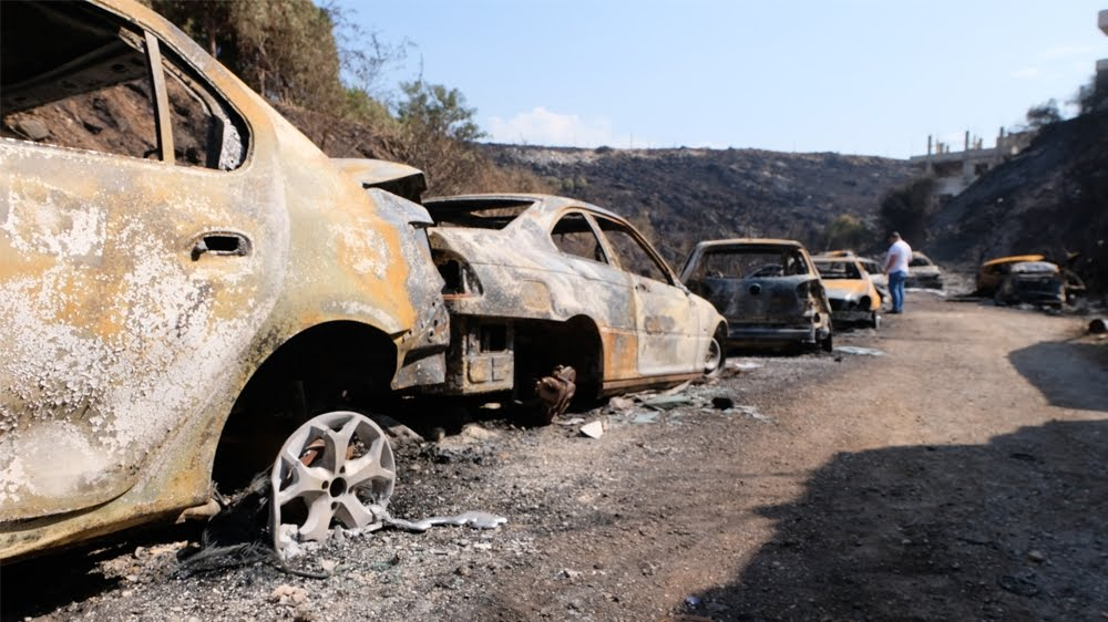 Intense fires in Lebanon's Chouf region charred vehicles at a garage owned by Damour resident Walid Mansour [Timour Azhari/Al Jazeera]