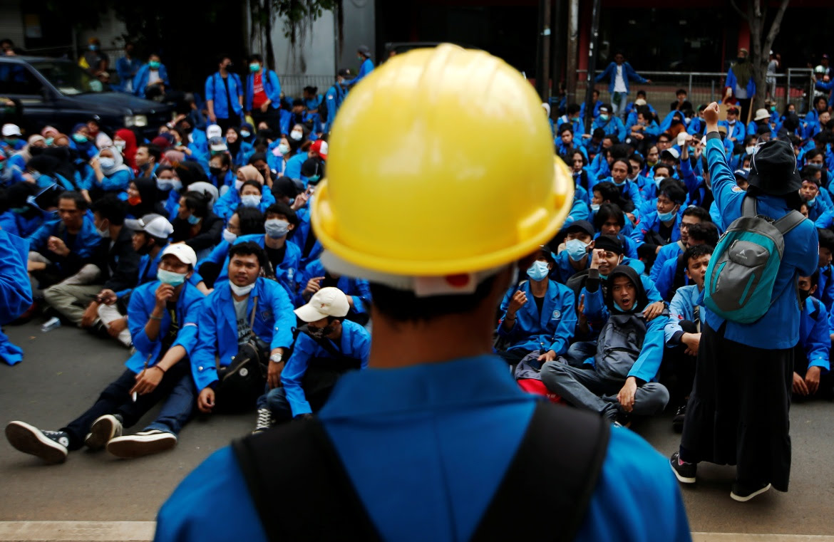 """Protesters say the """"omnibus"""" jobs creation bill, passed into law on Monday, undermines labour rights and weakens environmental protections. [Willy Kurniawan/Reuters]"""