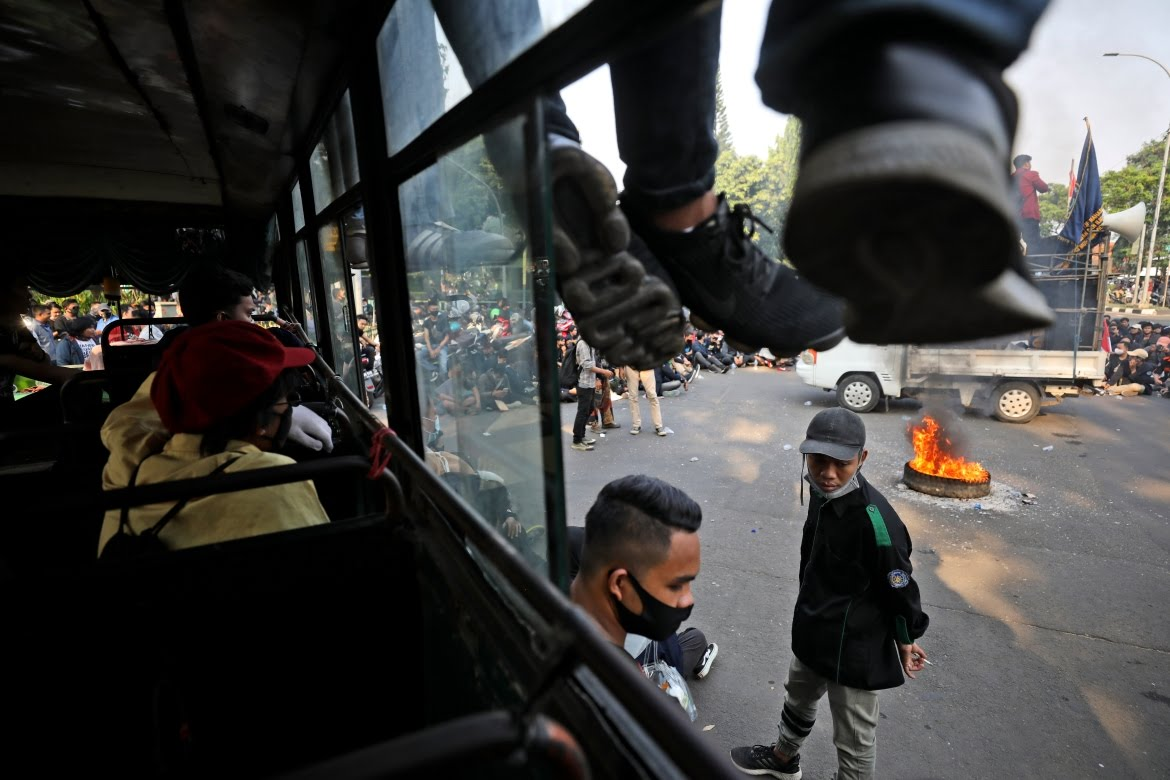 Two students have been seriously injured in the past two days of protests. [Dita Alangkara/AP Photo]