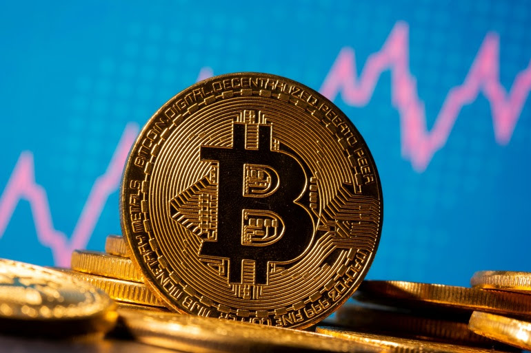 Even with Thursday's retreat, Bitcoin has more than doubled this year and until recently was nearing its 2017 record high [File: Dado Ruvic/Illustration/Reuters]